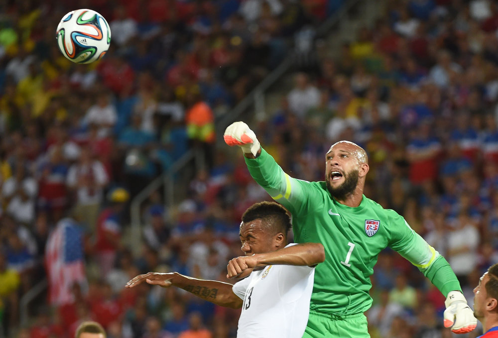 Description of . US goalkeeper Tim Howard (R) vies with Ghana's forward Jordan Ayew (L) during a Group G football match between Ghana and US at the Dunas Arena in Natal during the 2014 FIFA World Cup on June 16, 2014.  EMMANUEL DUNAND/AFP/Getty Images