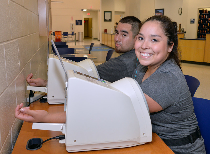 Students Gabriela Martinez and Luis Gomez check their blook pressure after workout.