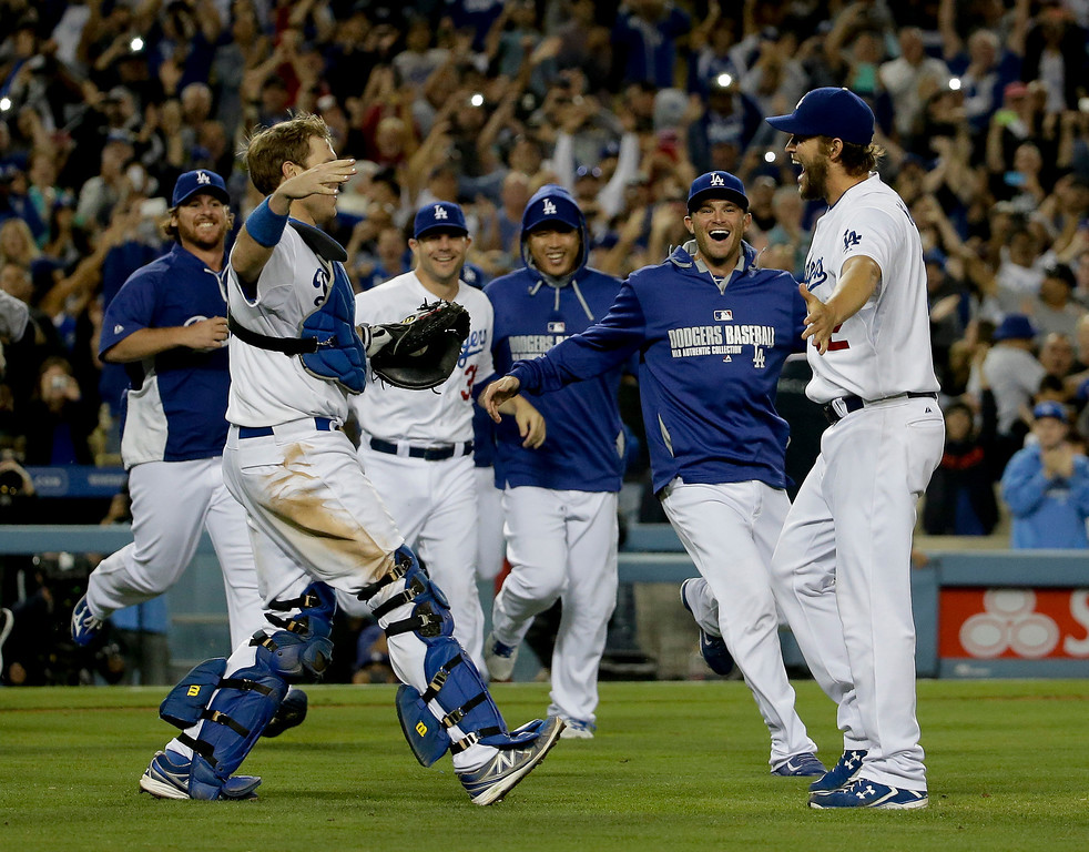 . Los Angeles Dodgers starting pitcher Clayton Kershaw celebrates his no hitter with his teammates against the Colorado Rockies after a baseball game in Los Angeles, Wednesday, June 18, 2014. Kershaw struck out a career-high 15 batters. (AP Photo/Chris Carlson)