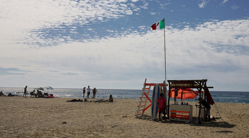 Sunny skies and a life-guard station on the beach in San Pancho, Mexico.