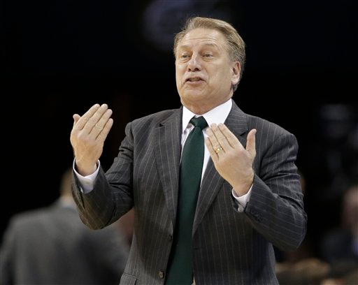. Michigan State head coach Tom Izzo directs his team against Virginia during the second half of an NCAA tournament college basketball game in the Round of 32 in Charlotte, N.C., Sunday, March 22, 2015. (AP Photo/Gerald Herbert)
