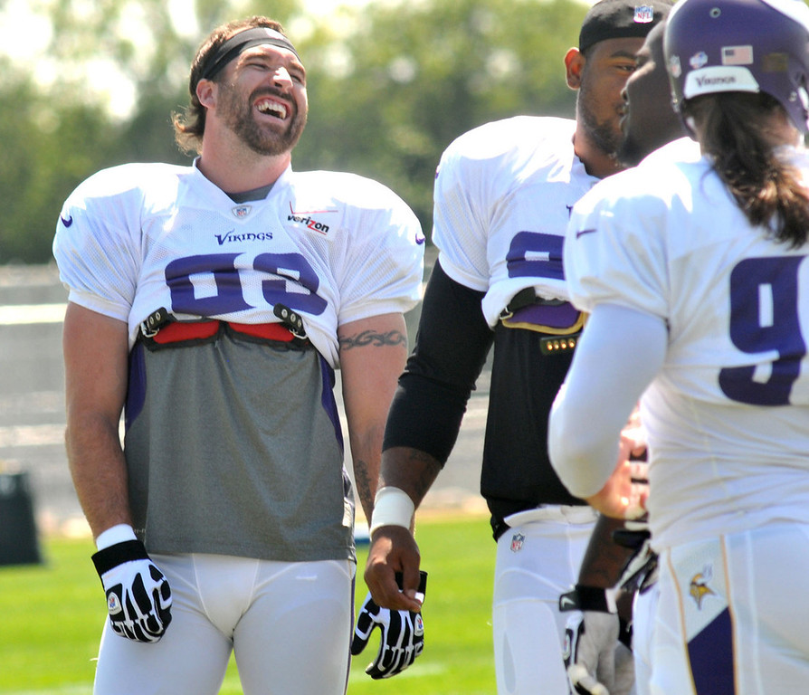 . Jared Allen, left, jokes with his teammates during a walk-through.   (Pioneer Press: John Doman)