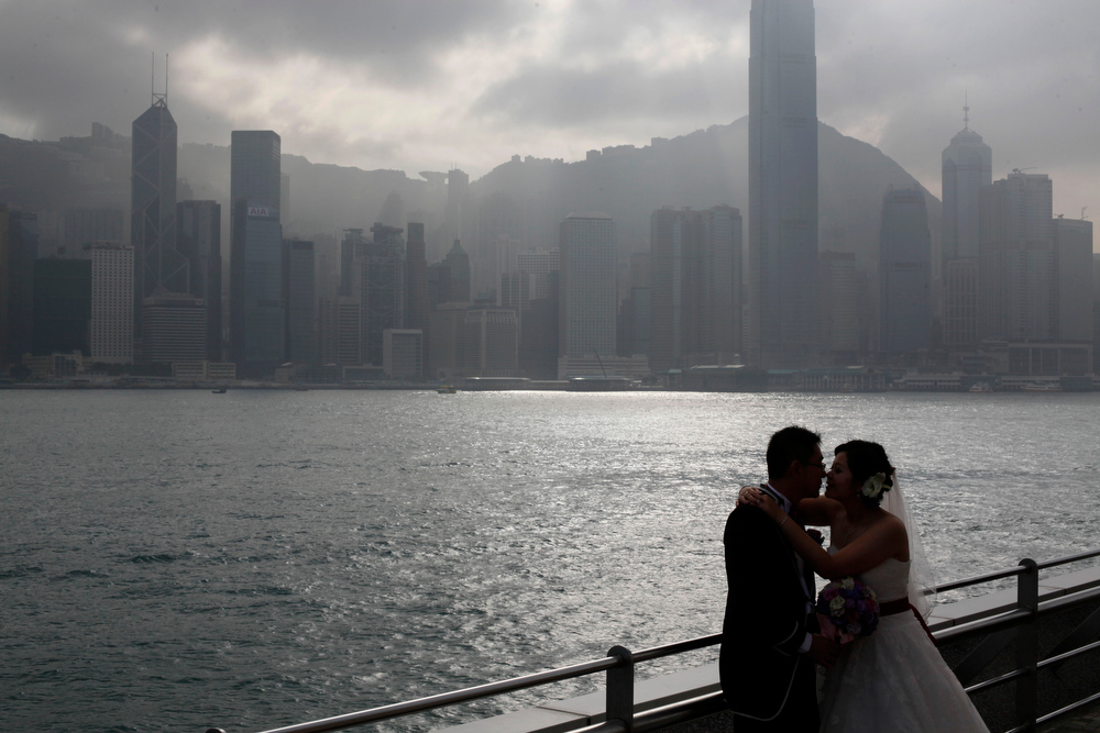 Description of . A couple poses for their wedding pictures in Hong Kong Friday Dec. 21, 2012. Many people around the world believe that the Mayan people predicted the end of the world Dec. 21. (AP Photo/Kin Cheung)