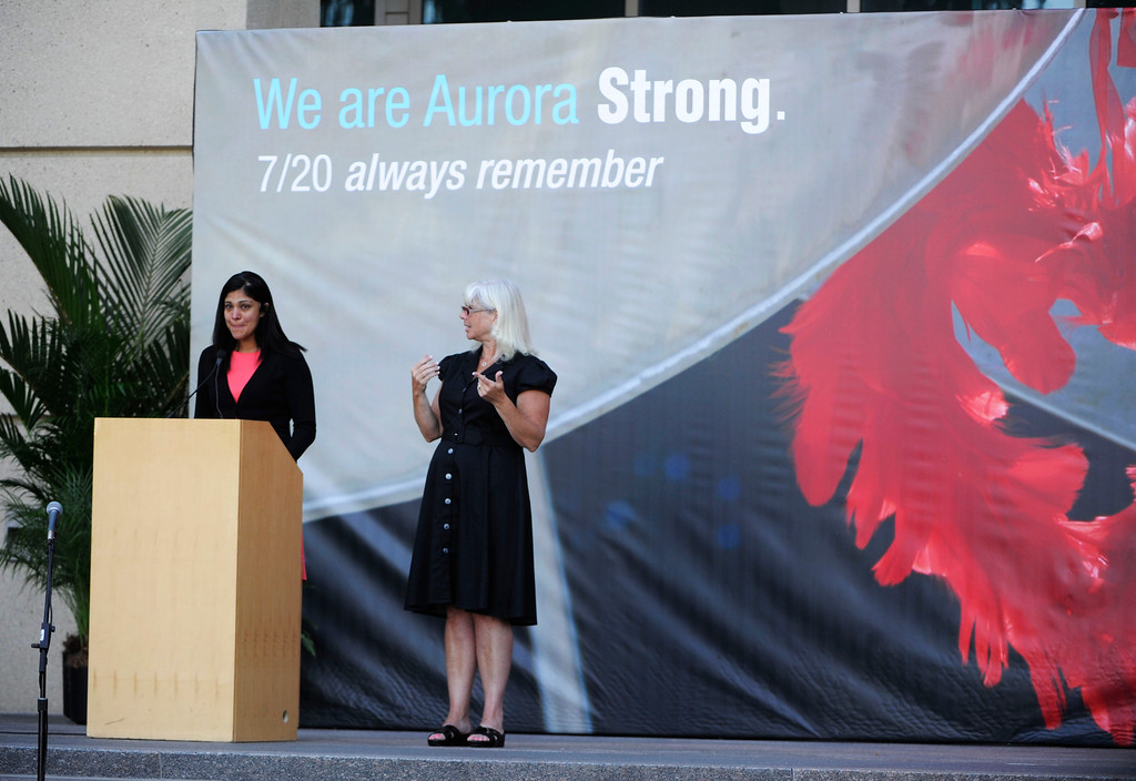 . AURORA, CO - JULY 20:  Camilla Sasson, MD, University of Colorado Hospital department of emergency medicine, left, fights back tears during a speech at the 7/20 Day of Remembrance 2013 at the Aurora Municipal Center Saturday morning, July 20, 2013. Over 200 people attended the service in honor of the 12 people killed and over 60 people injured in last years Aurora theater shooting. Sasson attended to many of the victims the night of the shooting, july 20, 2012. The service included prayer, songs and speeches from local officials and the Governor of Colorado, John Hickenlooper. (Photo By Andy Cross/The Denver Post)