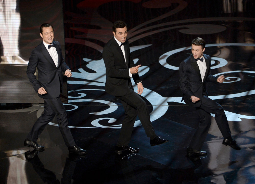 Description of . Actor Joseph Gordon-Levitt, host Seth MacFarlane and actor Daniel Radcliffe dance onstage during the Oscars held at the Dolby Theatre on February 24, 2013 in Hollywood, California.  (Photo by Kevin Winter/Getty Images)