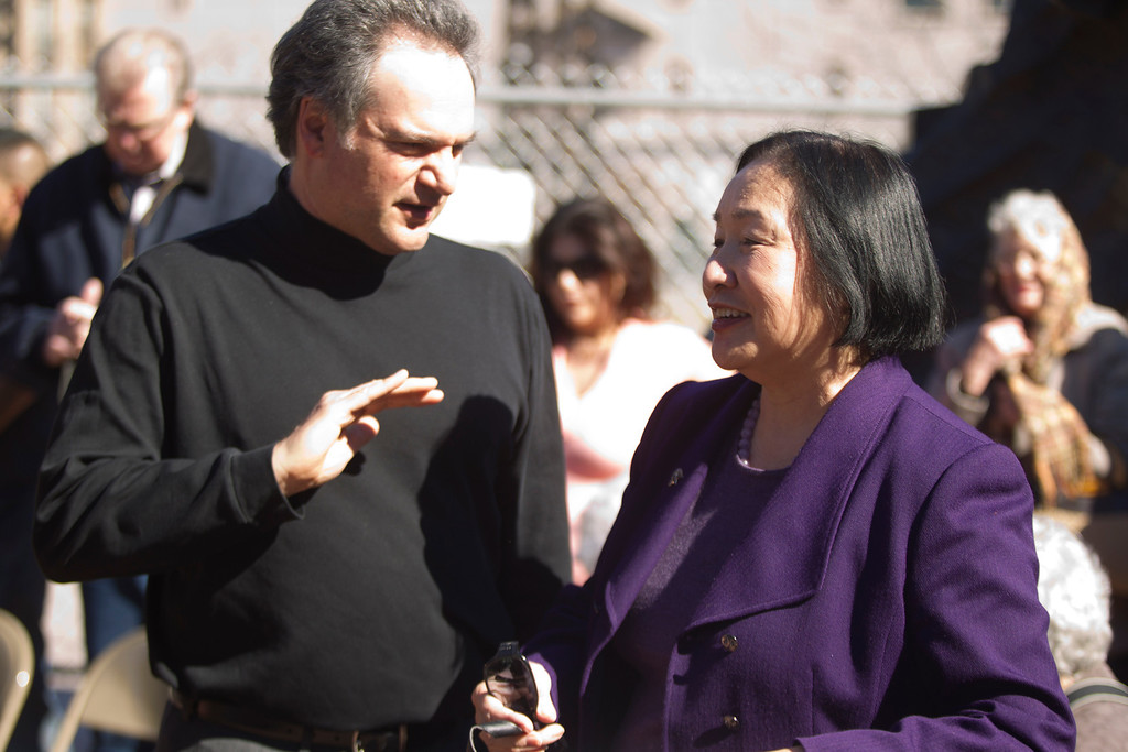 """. Artist Mario Chiodo, left, and Oakland, Calif. Mayor Jean Quan chat before the start of a ceremony to dedicate the final section of \""""Remember Them,\"""" Chiodo\'s paean to heroes of civil rights and humanity, Thursday, Feb. 21, 2013 in Oakland Calif. (D. Ross Cameron/Staff)"""