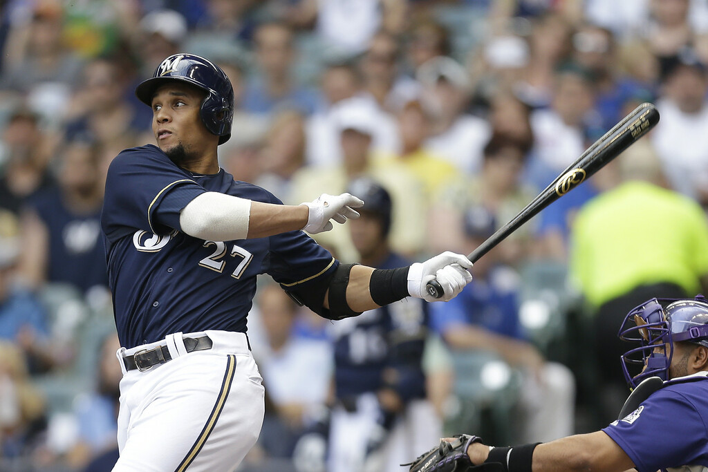 . MILWAUKEE, WI - JUNE 28: Carlos Gomez #27 of the Milwaukee Brewers hits a three run homer in the top of the first inning against the Colorado Rockies at Miller Park on June 28, 2014 in Milwaukee, Wisconsin. (Photo by Mike McGinnis/Getty Images)