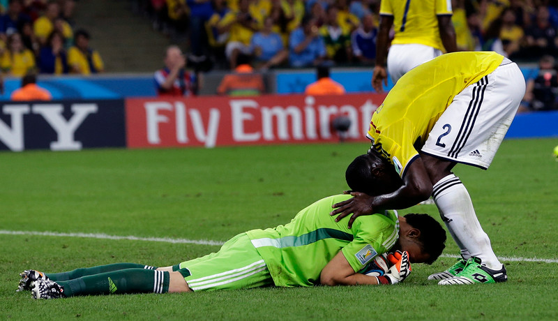 . Colombia\'s Cristian Zapata greets goalkeeper David Ospina after he made a save during the World Cup round of 16 soccer match between Colombia and Uruguay at the Maracana Stadium in Rio de Janeiro, Brazil, Saturday, June 28, 2014. (AP Photo/Sergei Grits)