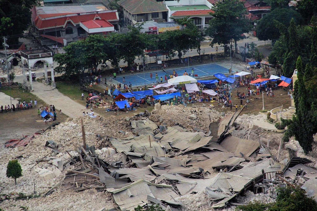 . This handout photo taken on October 16, 2013 and released on October 17 by the Philippine air force (PAF) shows an aerial shot of quake-affected residents sheltering on temporary tents next to the destroyed church in the town of Loon, Bohol province, central Philippines, after a 7.1 earthquake hit the tourist island destination october 15.  AFP PHOTO/PAF                                    AFP PHOTO /PAF HO/AFP/Getty Images