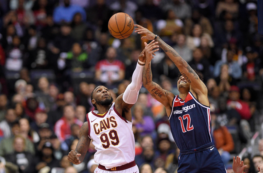 . Cleveland Cavaliers forward Jae Crowder (99) battles for the ball against Washington Wizards forward Kelly Oubre Jr. (12) during the first half of an NBA basketball game, Sunday, Dec. 17, 2017, in Washington. (AP Photo/Nick Wass)
