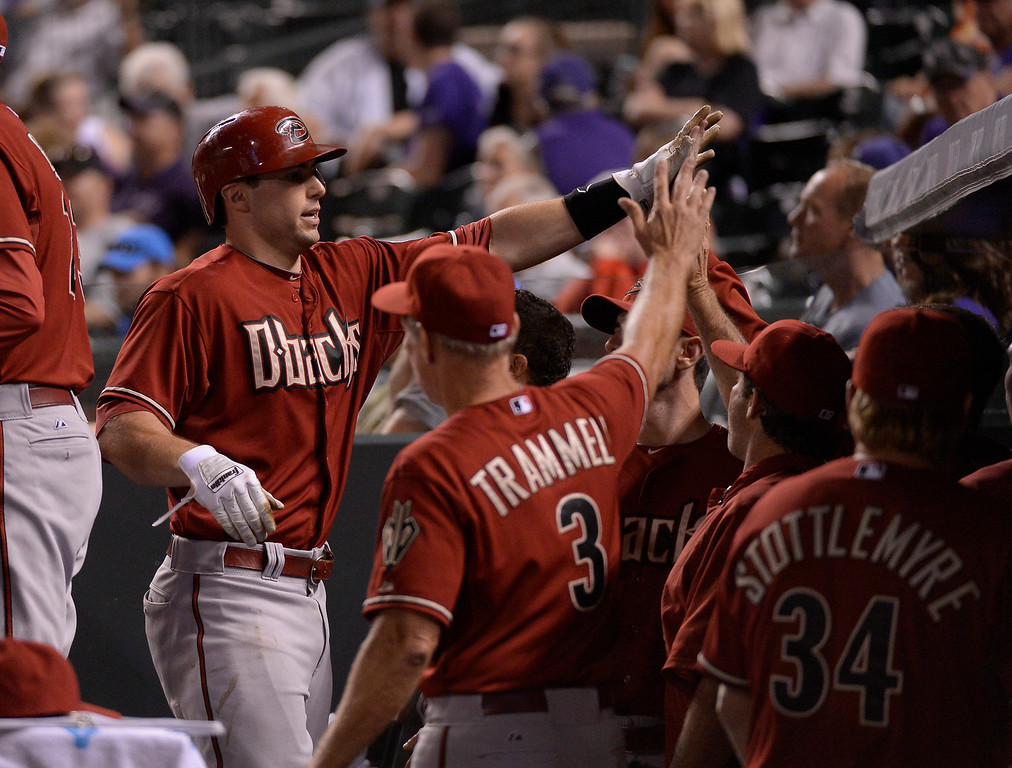 . Arizona Diamondbacks first baseman Paul Goldschmidt (44) high fives teammates in the dugout after scoring in the eighth inning June 4, 2014 at Coors Field. (Photo by John Leyba/The Denver Post)