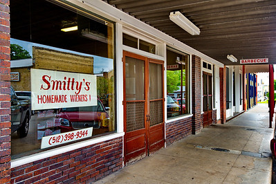 Smitty's Barbeque, Lockhart, TX After we took our photos of the courthouse it was after 11:30, lunch time.  We asked about the most popular barbeque place in Lockhart and we were directed to Smitty's, about a block from the courthouse.  Like other small town BBQ places, Smitty's serves its meat on brown paper plates and you buy it by the weight.  The three of us sat down and chowed down on brisket, sausage and all the fixins.  Yumm.  I'm ready to go back to Lockhart.