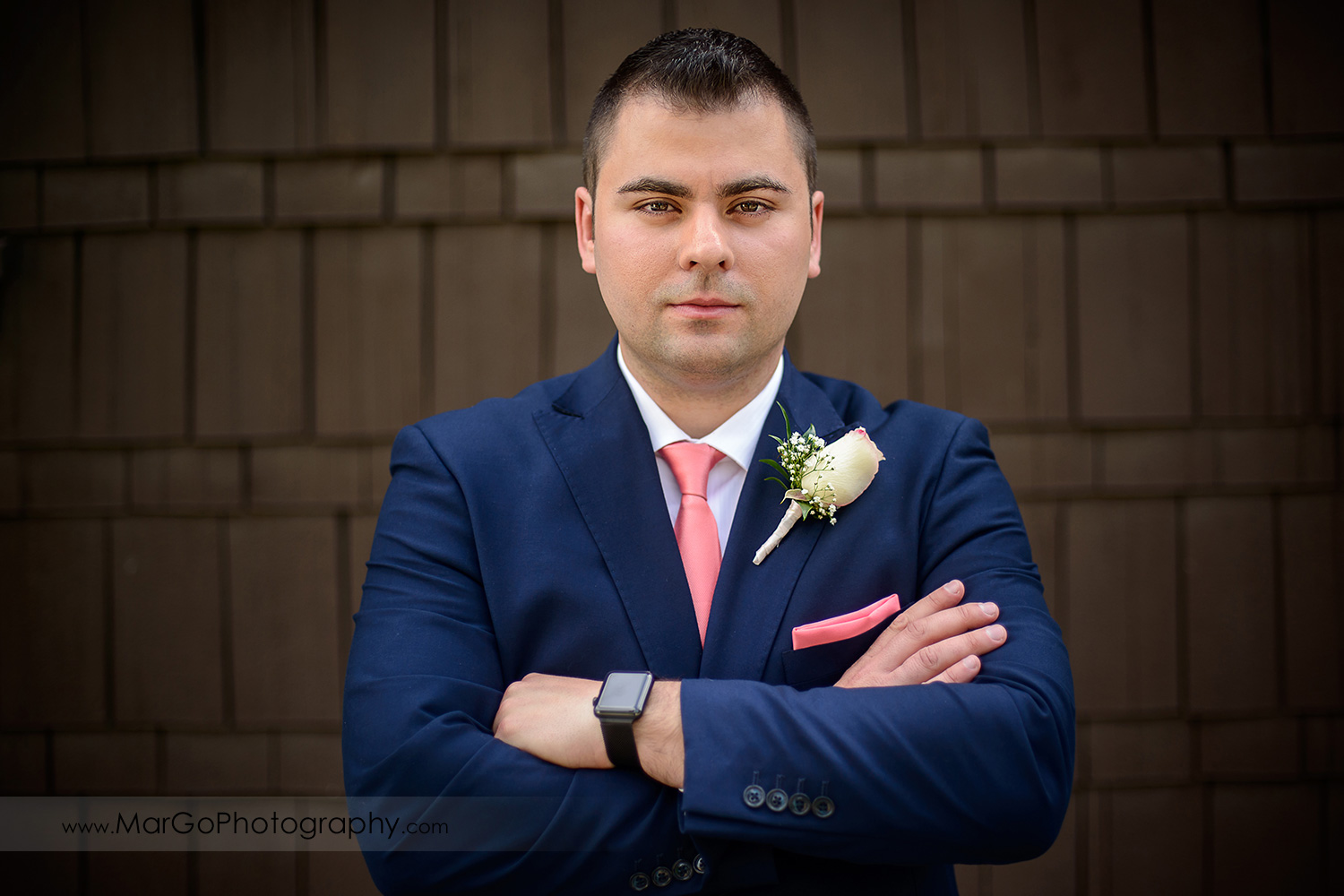 portrait of groom in blue suit and pink tie at Saratoga Foothill Club