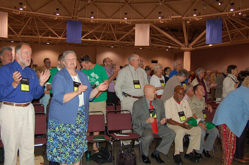 Lutherans rise to their feet in celebration of the rousing Gospel music.