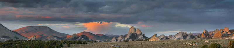 """The Twin Sisters, City of Rocks - Idaho  Early morning light on a clearing storm in the heart of the City of Rocks National Reserve. The Twin Sisters was a notable granite signpost for the pioneer families crossing the country and working their way to the west coast. In the 1840's, the California Trail passed just to the left side of the these towering formations - and can still be seen today.  This image was created at a panoramic size that will not print within the confines of the print house associated with SmugMug.  Contact me directly if you wish to purchase this image. rhartimages@gmail.com It is available in 36""""x7.5"""", 48""""x10"""", and 60""""x 12.5""""."""