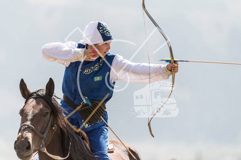 Female horseback archer releasing the arrow during a competition at the World Nomad Games 2018 in Kyrgyzstan.