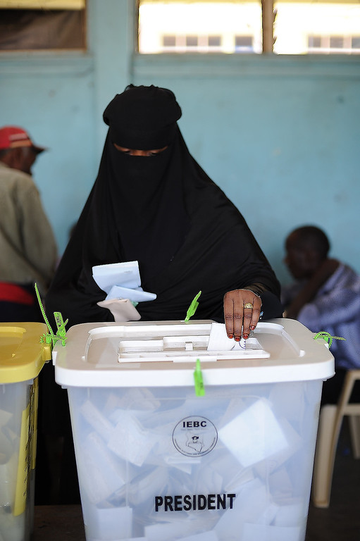 . A Somali-Kenyan woman in the Eastleigh neighborhood of Nairobi votes at Eastleigh High School during the elections on March 4, 2013. Long lines of Kenyans queued from far before dawn to vote Monday in the first election since the violence-racked polls five years ago, with a deadly police ambush hours before polling started marring the key ballot. The tense elections are seen as a crucial test for Kenya, with leaders vowing to avoid a repeat of the bloody 2007-8 post-poll violence in which over 1,100 people were killed, with observers repeatedly warning of the risk of renewed conflict.    Jennifer Huxta/AFP/Getty Images