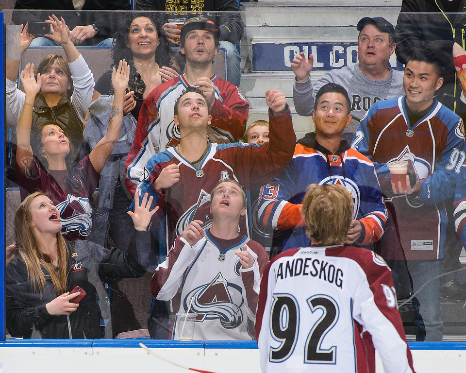 . Gabriel Landeskog #92 of the Colorado Avalanche sends a puck over the glass to fans during warm-ups prior to an NHL game against the Edmonton Oilers at Rexall Place on April 8, 2014 in Edmonton, Alberta, Canada. (Photo by Derek Leung/Getty Images)