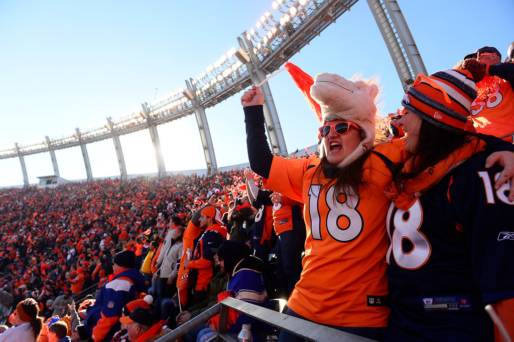 . Courtney Tamulis and Jenna  Balance celebrate a catch at Sports Authority Field at Mile High on January 17, 2016 in Denver, Colorado. Denver Broncos take on the Pittsburgh Steelers in the AFC Divisional Playoffs. (Photo by Brent Lewis/The Denver Post)