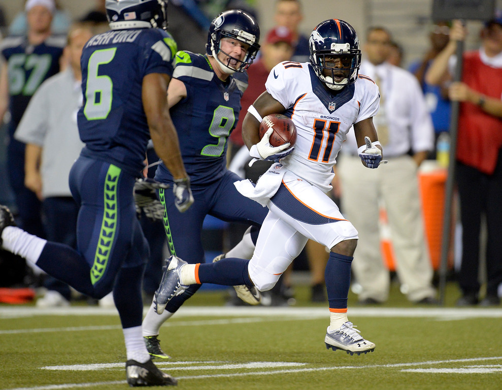 . SEATTLE, WA. - AUGUST 17: Denver Broncos wide receiver Trindon Holliday (11) gets chased by Seattle Seahawks wide receiver Perez Ashford (6) and Seattle Seahawks punter Jon Ryan (9) as he returns a punt in the fourth quarter August 17, 2013 at Century Link Field. (Photo By John Leyba/The Denver Post)