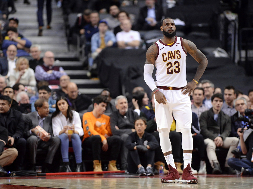 . Cleveland Cavaliers forward LeBron James (23) reacts during a break in play during the second half of the team\'s NBA basketball game against the Toronto Raptors on Thursday, Jan. 11, 2018, in Toronto. (Frank Gunn/The Canadian Press via AP)
