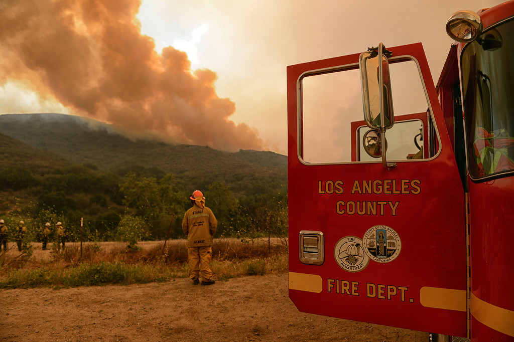 . A LACO Fire truck stands by as the Springs Fire moves closer along W Potrero Rd in Thousand Oaks Friday, May 3, 2013. (Hans Gutknecht/LA Daily News)
