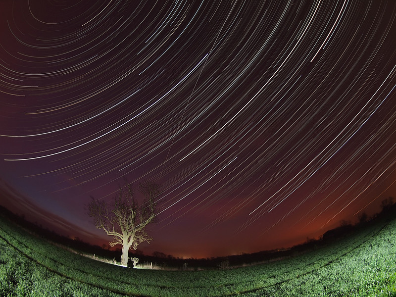 March 28/29 2012. Nice fisheye capture of startrail bisected by the 0531 hrs ISS pass. Captured with Olympus E5 & 8mm fisheye. Approx 1500 15s shots in this final composite. F3.5, ISO 500. Tree and field lit by remote flash.