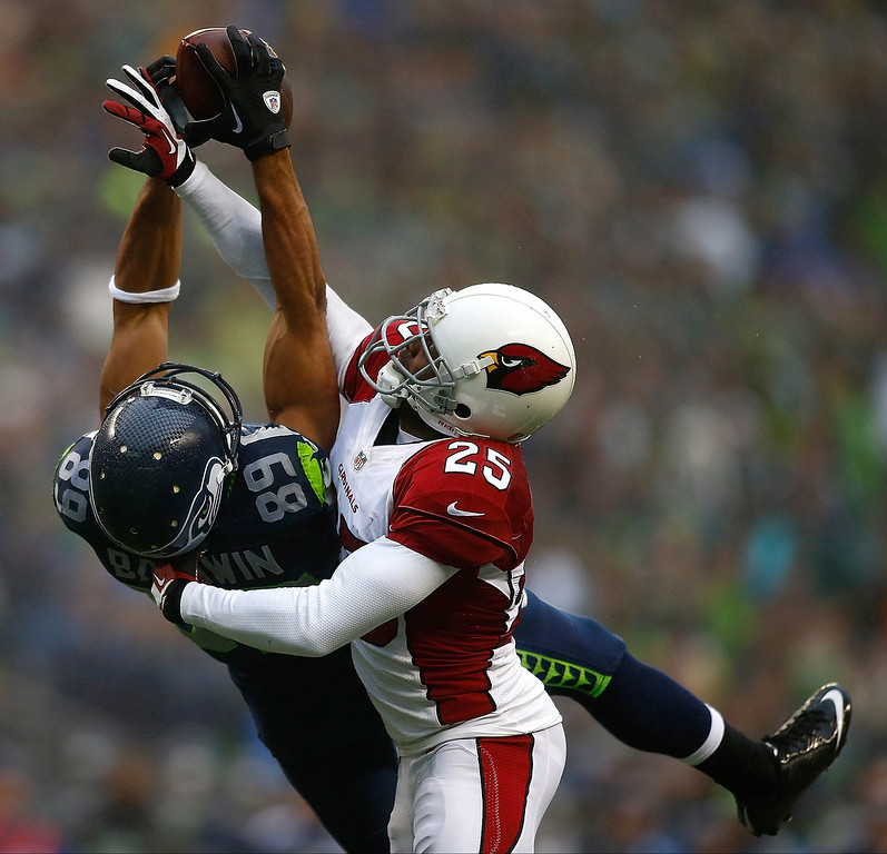 . Jerraud Powers #25 of the Arizona Cardinals breaks up a passs to Doug Baldwin #89 of the Seattle Seahawks on December 22, 2013 at CenturyLink Field in Seattle, Washington.  (Photo by Jonathan Ferrey/Getty Images)