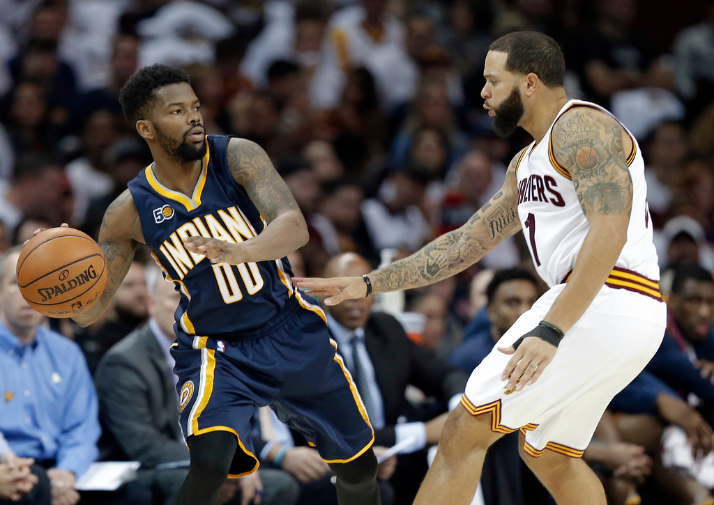 . Indiana Pacers\' Aaron Brooks, left, looks to pass against Cleveland Cavaliers\' Deron Williams in the first half in Game 1 of a first-round NBA basketball playoff series, Saturday, April 15, 2017, in Cleveland. (AP Photo/Tony Dejak)