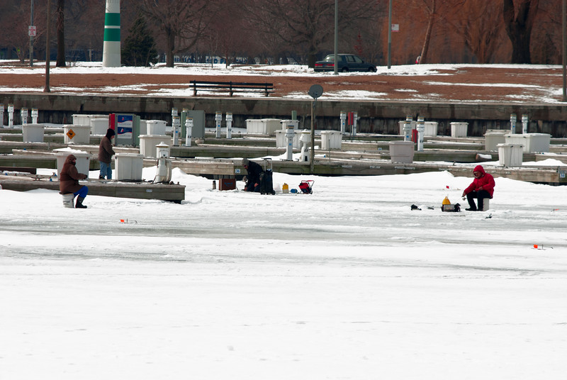 The ice fisher in the red jacket