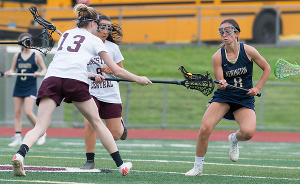 05/10/19 Wesley Bunnell | Staff Newington girls lacrosse defeated Bristol Central in an away game at Bristol Central High School on Friday afternoon. BC's Jade Longo (13) Newington's Taylor D'Anna (8).