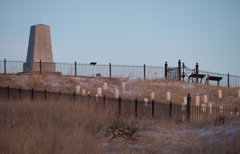 Historic gravemarkers surrounded by a fence at Little Bighorn National Battlefield