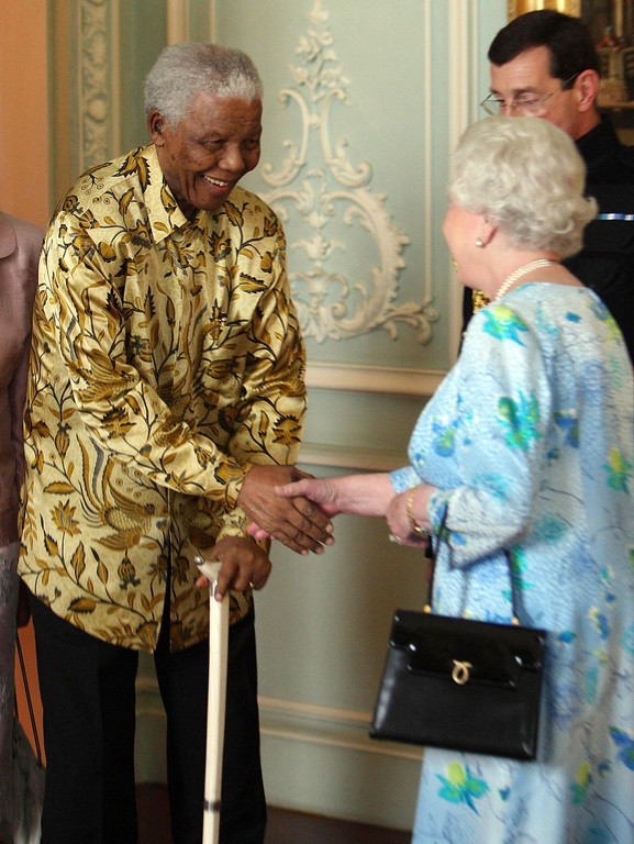 . Britain\'s Queen Elizabeth,  right,  meets former South African President Nelson Mandela at Buckingham Palace, London  Wednesday June 25, 2008. The meeting is part of a week long visit marking the former South African President\'s 90th birthday, which is next month. Person at right is unidentified (AP Photo/Dominic Lipinski/Pool)