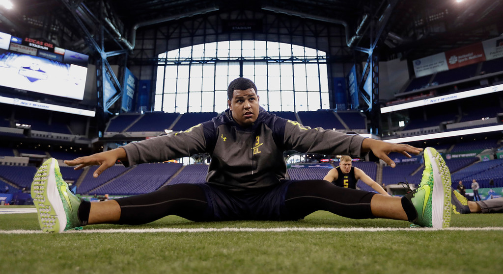 . USC offensive lineman Zach Banner stretches at the NFL football scouting combine Friday, March 3, 2017, in Indianapolis. (AP Photo/David J. Phillip)