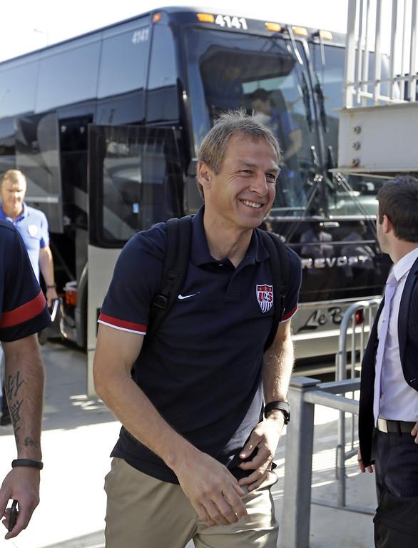 . U.S. national soccer team head coach Jurgen Klinsmann walks from a bus after arriving at Rio Tinto Stadium before the start an World Cup qualifying soccer match between Honduras and the U.S. Tuesday, June 18, 2013, in Sandy, Utah.  (AP Photo/Rick Bowmer)