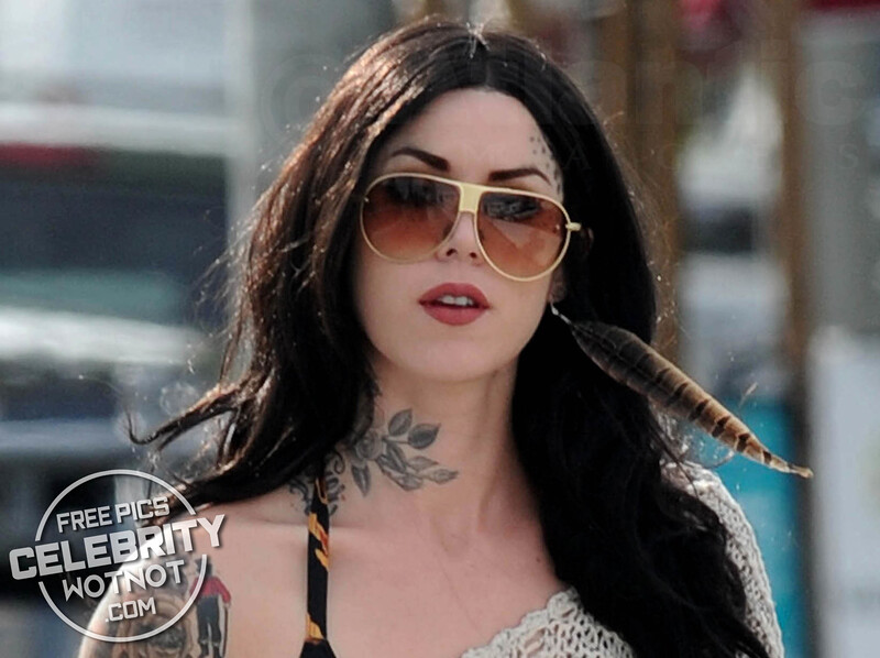 Kat Von D Flashes A Leopard Print Bikini Top, Wears A Feather Earring And Shows Off Her Tattoos, LA