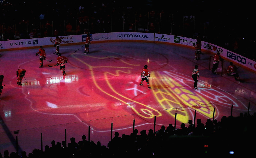 . Members of the Chicago Blackhawks skate during player introductions before a game against the Colorado Avalanche at the United Center on March 6, 2013 in Chicago, Illinois.  (Photo by Jonathan Daniel/Getty Images)