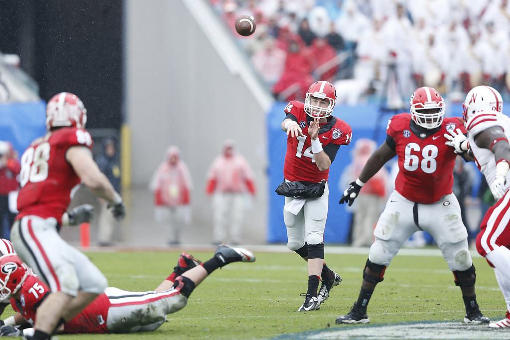 . Hutson Mason #14 of the Georgia Bulldogs throws a pass in the first half against the Nebraska Cornhuskers during the TaxSlayer.com Gator Bowl at Everbank Field on January 1, 2014 in Jacksonville, Florida. (Photo by Joe Robbins/Getty Images)
