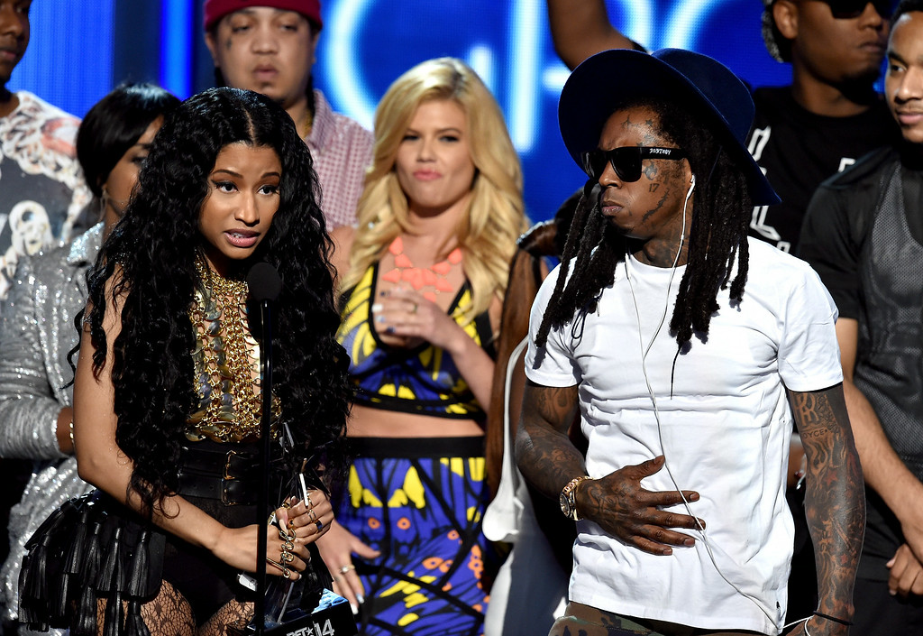 . Singer Nicki Minaj (L) and rapper Lil Wayne of Young Money accept Best Group onstage during the BET AWARDS \'14 at Nokia Theatre L.A. LIVE on June 29, 2014 in Los Angeles, California.  (Photo by Kevin Winter/Getty Images for BET)