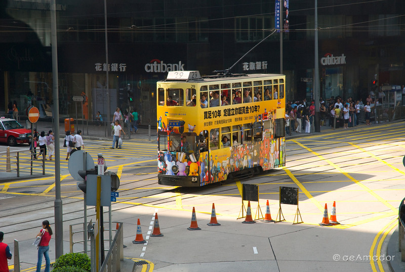 aeamador©-HK08_DSC0048  Hong Kong, downtown area, near ifc tower. I was very impressed by the affluence evidenced in this area. Hong Kong is quite a chic and fine place. The Hong Kong trolley or tram. They are all different because they are moving ad billboards.