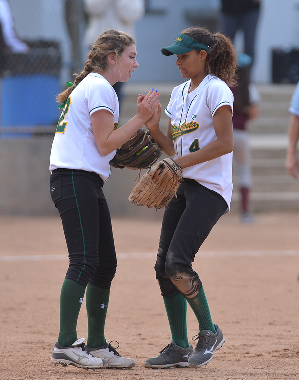 . 0517_SPT_TDB-L-MC-TORRANCE--- Torrance, CA--5/16/13--- Staff Photo: Robert Casillas  - Daily Breeze / LANG--- Mira Costa defeated Torrance High 7-1 in CIF DIV III softball playoff game at Wilson Park in Torrance. Dillan Boada and Sydney Haugh.