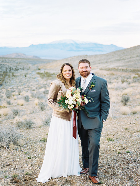 Robert Bullock bridal gown with gold jacket // bridal bouquet with protea, scabiosa, eucalyptus and garden roses - Rooted Willow // Las Vegas desert elopement // Las Vegas Elopement & Intimate Wedding Photographer - Kristen Krehbiel - Kristen Kay Photography