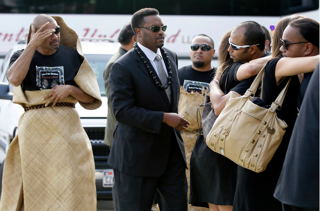 ". David Eteaki, left, looks on as Texas A&M  football head coach Kevin Sumlin, center, family, and members of his team are greeted at a receiving line before the start of a funeral service for redshirt freshman Polo Manukainiu and his brother Andrew Uhatafe, at the Church of Jesus Christ Of Latter Day Saints, Saturday, Aug. 10, 2013, in Colleyville, Texas. The two were killed in a single car accident in Northern New Mexico, July 29. Also killed was 18-year-old Utah recruit Gaius ""Keio\"" Vaenuku. (AP Photo/Tony Gutierrez)"