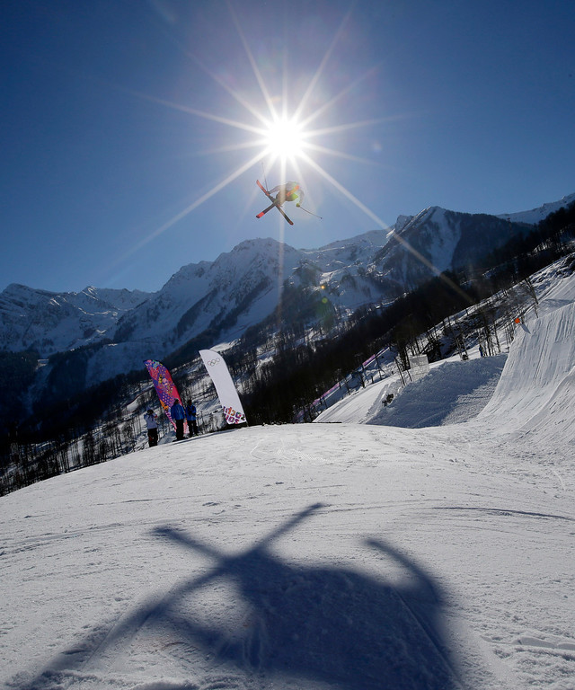 . A competitor takes a jump during a ski slopestyle training session at the Rosa Khutor Extreme Park, prior to the 2014 Winter Olympics, Wednesday, Feb. 5, 2014, in Krasnaya Polyana, Russia. (AP Photo/Andy Wong)