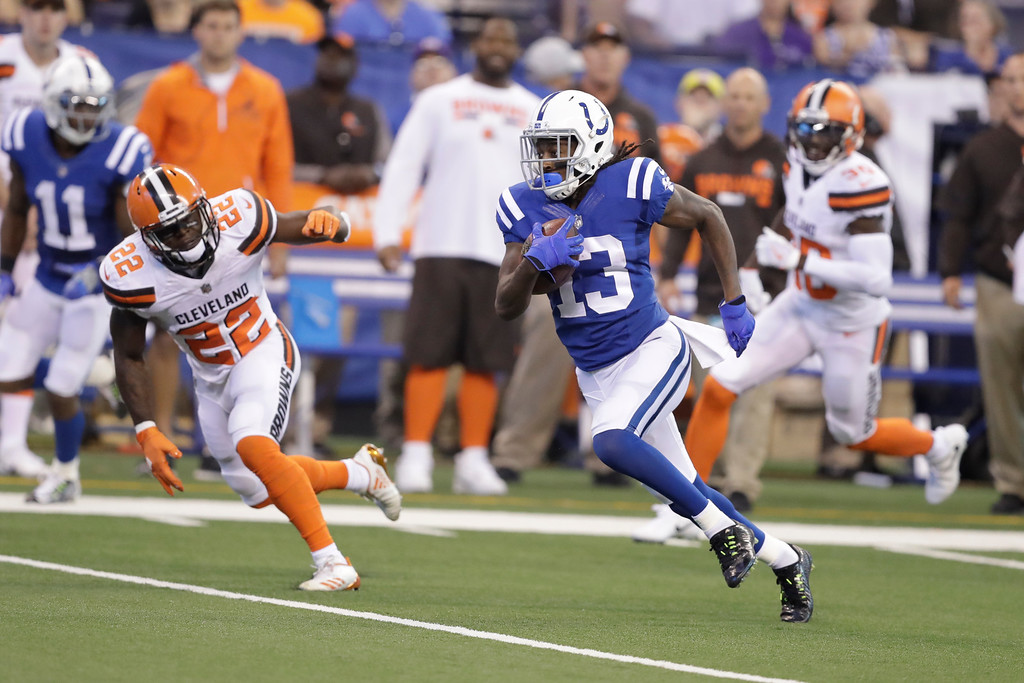 . Indianapolis Colts wide receiver T.Y. Hilton (13) cuts away from Cleveland Browns free safety Jabrill Peppers (22) on his way to a touchdown during the first half of an NFL football game in Indianapolis, Sunday, Sept. 24, 2017. (AP Photo/Darron Cummings)