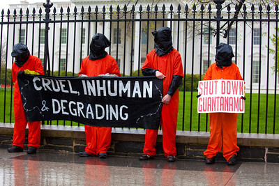 White House (4/15/09) Dressed in prisoner's garb, protestors demand the shutdown of The Guantanamo Bay detention camp on April 15, 2009 at the White House..