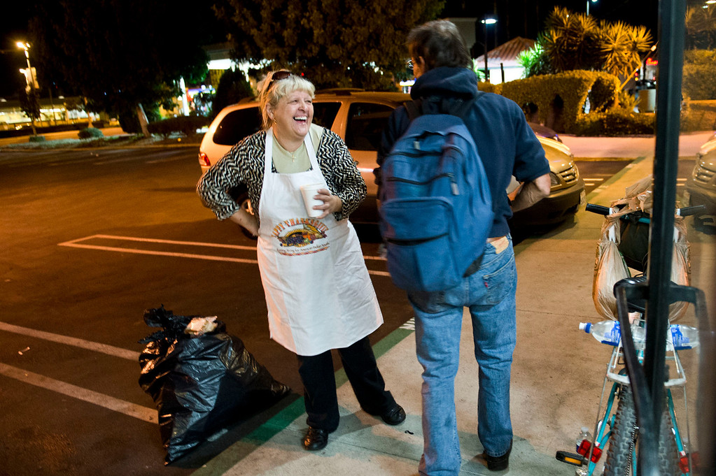 . Nicolette Wingert, left, chats with a homeless man in Glendora on Wednesday night, Nov. 27, 2013. Nicolette Wingert has been feeding the homeless six days a week for the past seven years with Nurses4Christ, a nonprofit organization she founded in 2006. She and Phillip Stern of Glendora have been going every day since 2008, feeding homeless people sandwiches and hot food; giving them bottles of water, clothes and blankets. (Photo by Watchara Phomicinda/San Gabriel Valley Tribune)