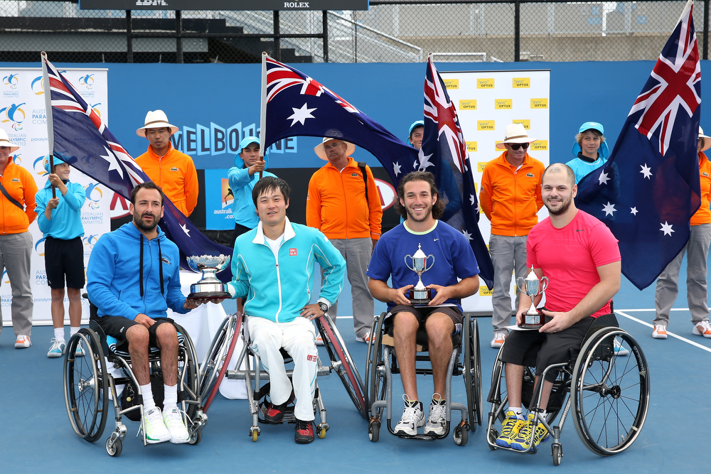 Description of . Shingo Kunieda of Japan and Michael Jeremiasz of France with the winners trophy, and Adam Kellerman of Australia and Stefan Olsson of Sweden with the runners up trophy after their Wheelchair Doubles Final against  at Melbourne Park on January 25, 2013 in Melbourne, Australia.  (Photo by Michael Dodge/Getty Images)