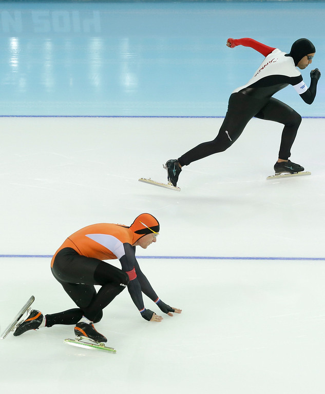 . Stefan Groothuis of the Netherlands falls as he takes the start with Canada\'s Muncef Ouardi, top, for the second heat of the men\'s 500-meter speedskating race at the Adler Arena Skating Center during the 2014 Winter Olympics, Monday, Feb. 10, 2014, in Sochi, Russia. (AP Photo/Patrick Semansky)