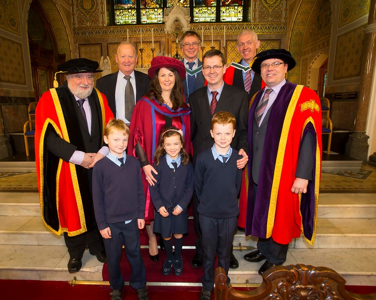 06/01/2015. FREE TO USE IMAGE. WIT (Waterford Institute of Technology) Conferring. Pictured is Angela Horgan-Goff, Waterford who was conferred a Doctor of Philosophy, also pictured are Jack Walsh, Deputy Chairman of W.I.T,  Prof Willie Donnelly WIT, Dr. Richard Hayes and Dr. Ruaidhrí Neavyn, President WIT and members of Angela's family, husband Darragh, dad Jeremiah and children Conor, Ciarán and Moillí.  Picture: Patrick Browne